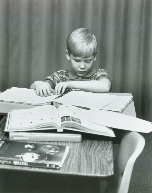 Student reading braille, 1990